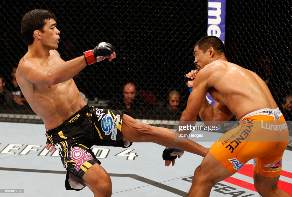 <a gi-track='captionPersonalityLinkClicked' href=/galleries/search?phrase=Lyoto+Machida&family=editorial&specificpeople=4137146 ng-click='$event.stopPropagation()'>Lyoto Machida</a> kicks <a gi-track='captionPersonalityLinkClicked' href=/galleries/search?phrase=Mark+Munoz&family=editorial&specificpeople=3029154 ng-click='$event.stopPropagation()'>Mark Munoz</a> in their middleweight bout during the UFC Fight Night event at Phones 4 U Arena on October 26, 2013 in Manchester, England.