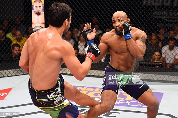 Lyoto Machida kicks Yoel Romero in their middleweight fight during the UFC Fight Night event at the Hard Rock Live on June 27 2015 in Hollywood...