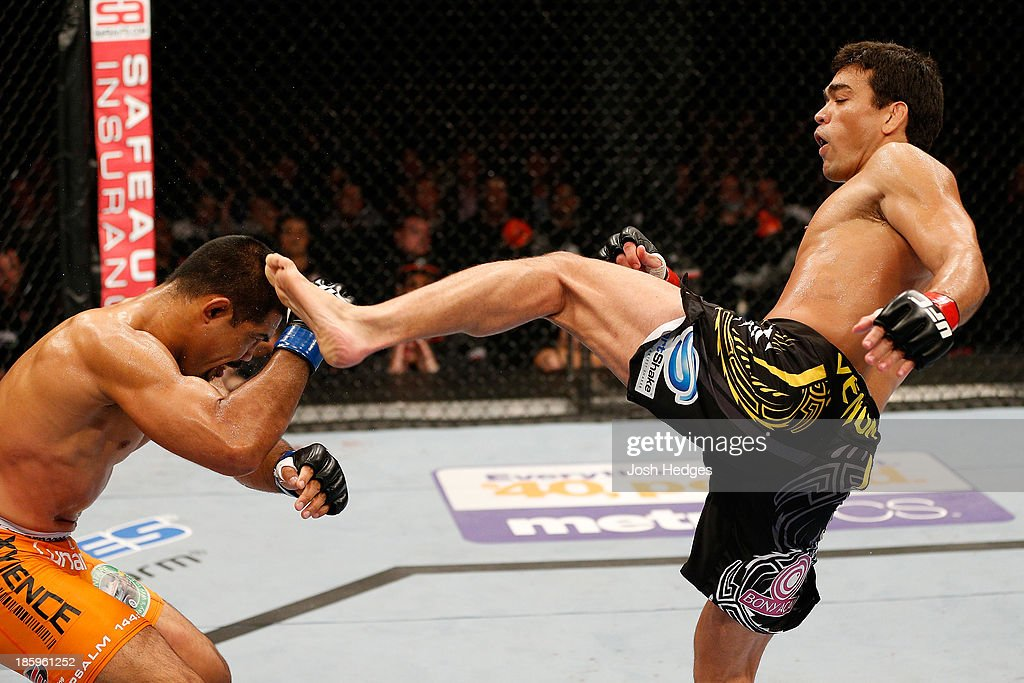 <a gi-track='captionPersonalityLinkClicked' href=/galleries/search?phrase=Lyoto+Machida&family=editorial&specificpeople=4137146 ng-click='$event.stopPropagation()'>Lyoto Machida</a> knocks out <a gi-track='captionPersonalityLinkClicked' href=/galleries/search?phrase=Mark+Munoz&family=editorial&specificpeople=3029154 ng-click='$event.stopPropagation()'>Mark Munoz</a> with a kick in their middleweight bout during the UFC Fight Night event at Phones 4 U Arena on October 26, 2013 in Manchester, England.