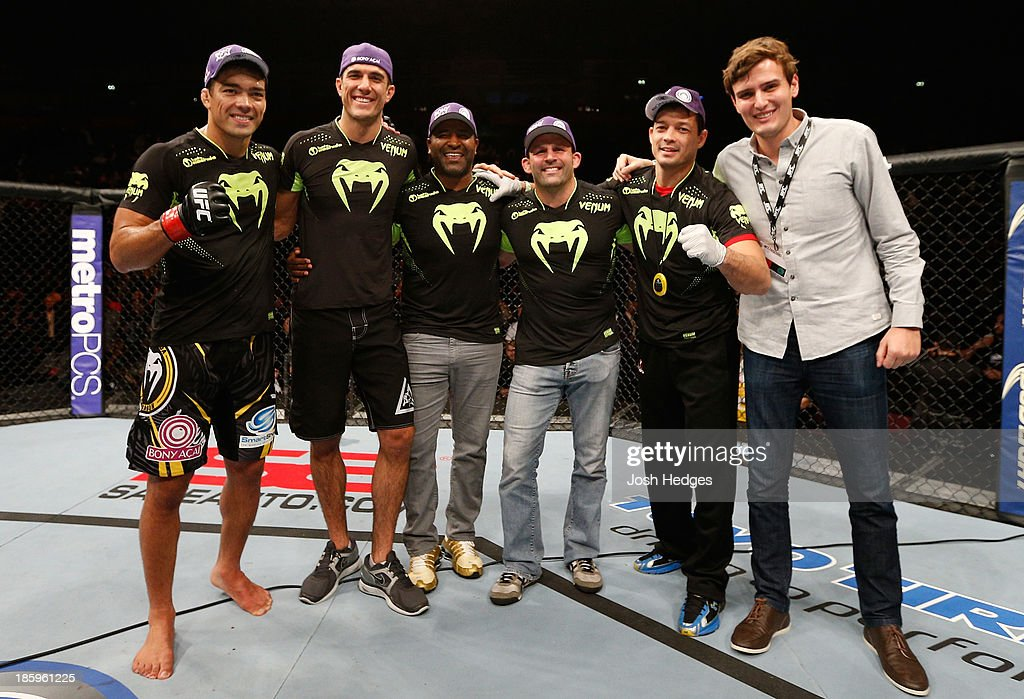 <a gi-track='captionPersonalityLinkClicked' href=/galleries/search?phrase=Lyoto+Machida&family=editorial&specificpeople=4137146 ng-click='$event.stopPropagation()'>Lyoto Machida</a> (L) poses for a photo with his team after his knockout victory over Mark Munoz in their middleweight bout during the UFC Fight Night event at Phones 4 U Arena on October 26, 2013 in Manchester, England.