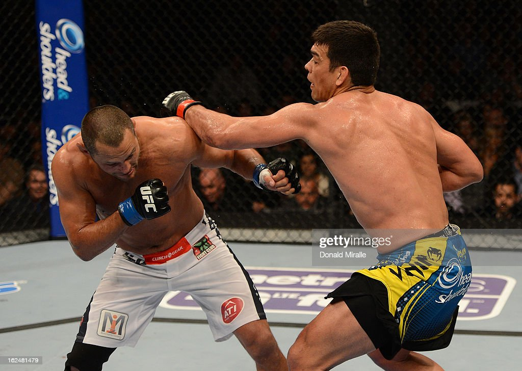 Lyoto Machida punches Dan Henderson in their light heavyweight bout during UFC 157 at Honda Center on February 23, 2013 in Anaheim, California.