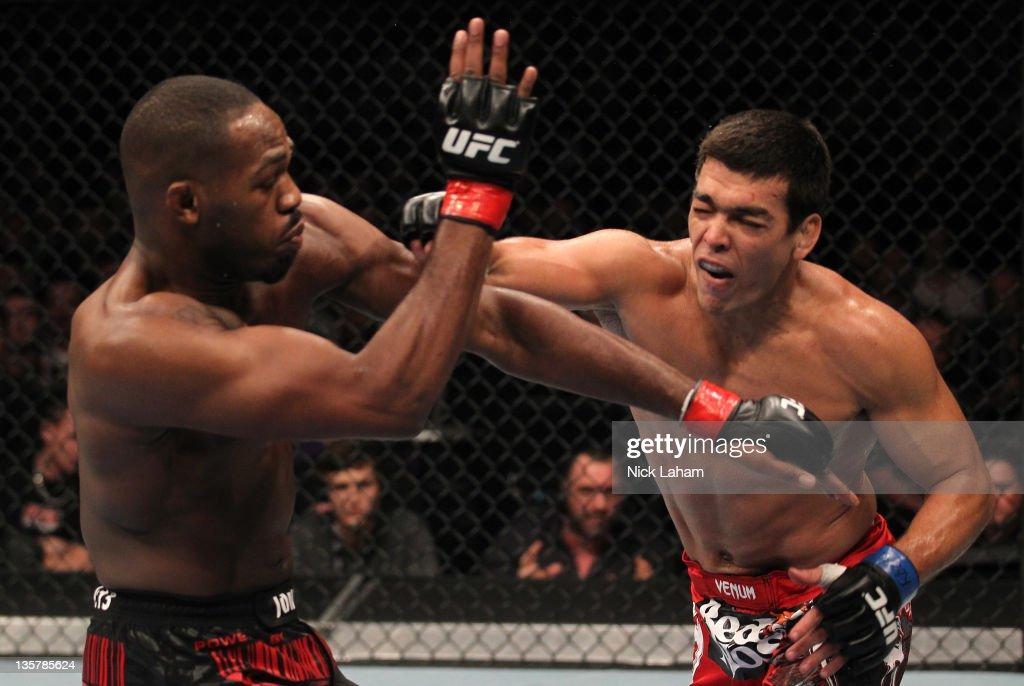 Lyoto Machida punches Jon 'Bones' Jones during the UFC 140 event at Air Canada Centre on December 10, 2011 in Toronto, Ontario, Canada.