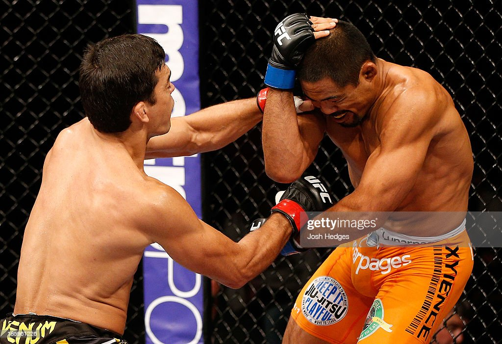 <a gi-track='captionPersonalityLinkClicked' href=/galleries/search?phrase=Lyoto+Machida&family=editorial&specificpeople=4137146 ng-click='$event.stopPropagation()'>Lyoto Machida</a> punches <a gi-track='captionPersonalityLinkClicked' href=/galleries/search?phrase=Mark+Munoz&family=editorial&specificpeople=3029154 ng-click='$event.stopPropagation()'>Mark Munoz</a> in their middleweight bout during the UFC Fight Night event at Phones 4 U Arena on October 26, 2013 in Manchester, England.