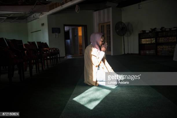 Lyric Harris a 19yearold student at Towson University prays at a Baltimore mosque Harris grew up in Washington DC and converted to Islam in high...