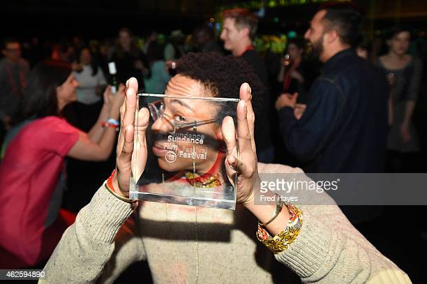 Lyric R Cabral of ERROR poses with award at the Awards Night Party during the 2015 Sundance Film Festival at the Basin Recreation Field House on...