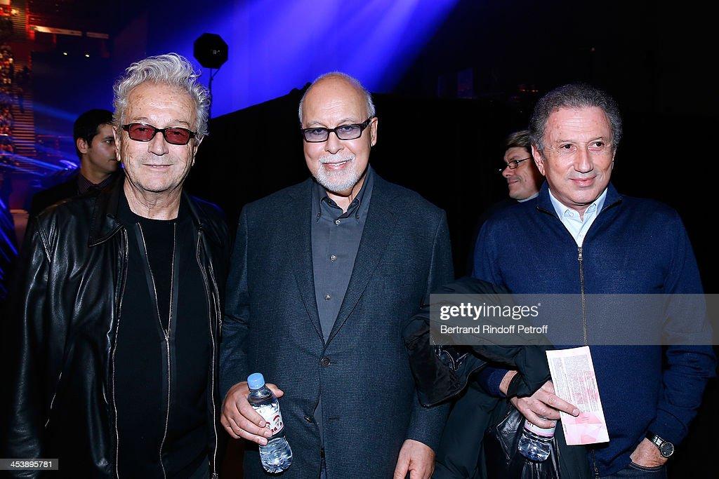 Lyricist Luc Plamondon, Rene Angelil and TV and Radio animator Michel Drucker attending Celine Dion's Concert at Palais Omnisports de Bercy on December 5, 2013 in Paris, France.