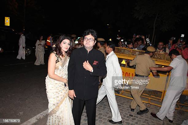 'NEW DELHI INDIA OCTOBER 18 Lyricist Prasoon Joshi with wife Aparna arriving to attend SaifKareena DawateWalima at 31 Aurangzeb Road 3 on October 18...