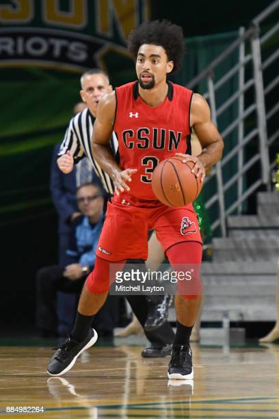 Lyrik Shreiner of the Cal State Northridge Matadors dribbles the ball during a college basketball tournament against the George Mason Patriots at the...