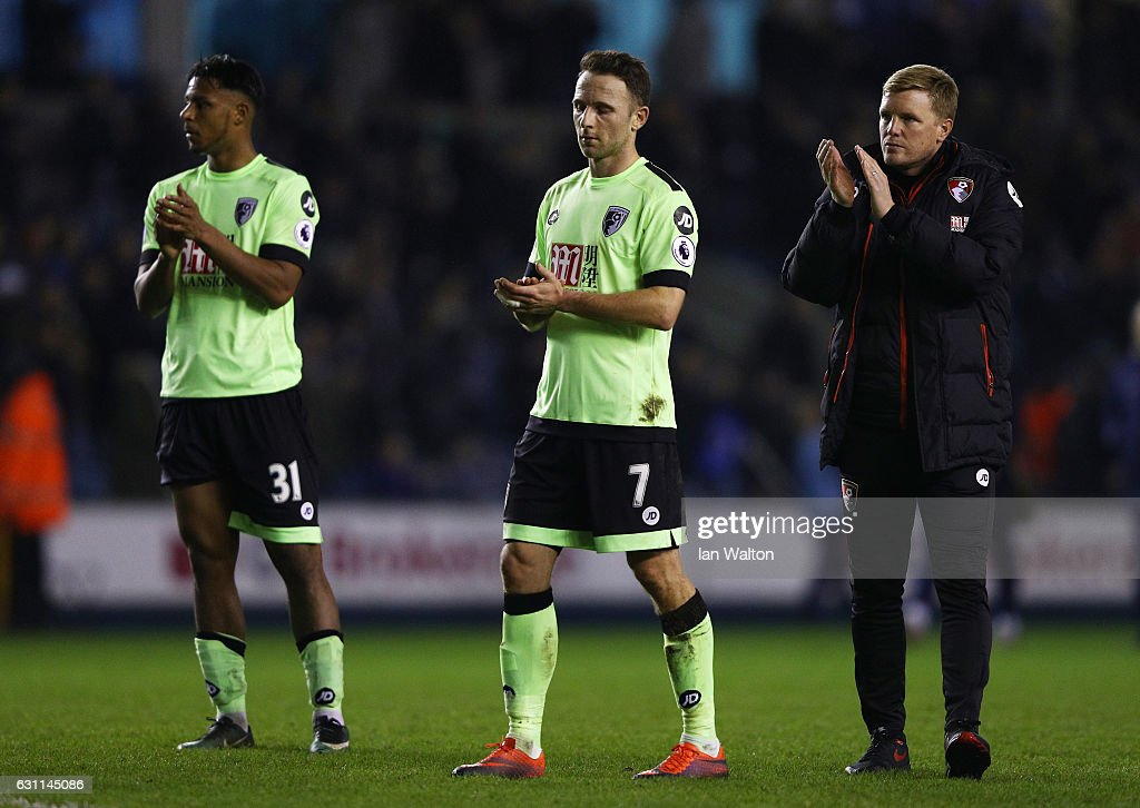 Lys Mousset, Marc Pugh and Eddie Howe manager of AFC Bournemouth react during the Emirates FA Cup third round match between Millwall and AFC Bournemouth at The Den on January 7, 2017 in London, England.