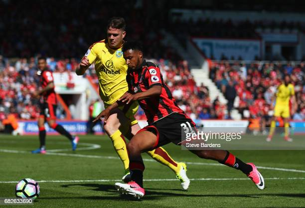 Lys Mousset of AFC Bournemouth attempts to get past Kevin Long of Burnley during the Premier League match between AFC Bournemouth and Burnley at...