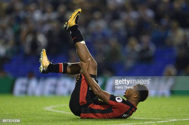 Lys Mousset of AFC Bournemouth goes down holding his knee during the Carabao Cup Second Round match between Birmingham City and AFC Bournemouth at St...