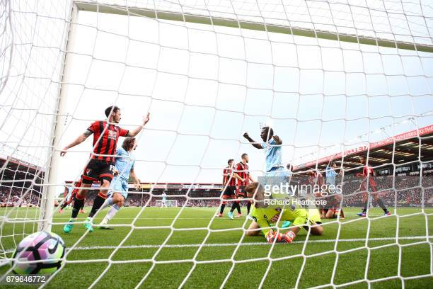 Lys Mousset of AFC Bournemouth scores a own goal for Stoke City's first goal of the game during the Premier League match between AFC Bournemouth and...