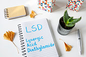 LSD Lysergic Acid Diethylamide written in a notebook on white table