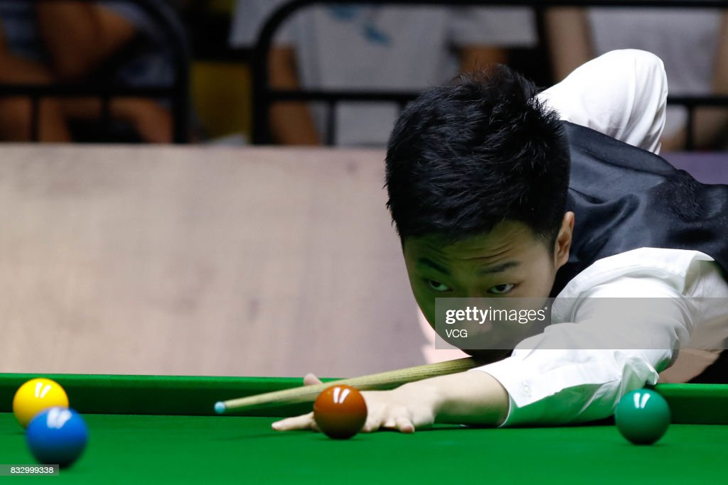 Lyu Haotian of China plays a shot during a qualifying match against John Higgins of Scotland on day one of Evergrande 2017 World Snooker China Champion at Guangzhou Sport University on August 16, 2017 in Guangzhou, Guangdong Province of China.