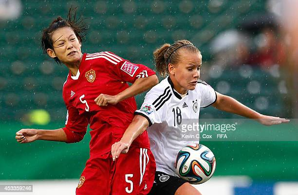 Lyu Siqi of China PR challenges Lena Petermann of Germany at Commonwealth Stadium on August 8 2014 in Edmonton Canada