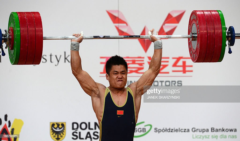 Lyu Xiaojun of China competes in clean and jerk competition in men's 77 kg during the weightlifting IWF World Championships Wroclaw 2013 at...