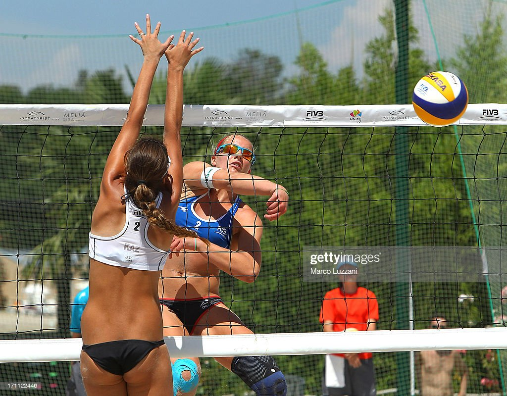Lyubov Bogatu of Kazakistan (R) smashes the ball against Jelena Wlk of Germany during FIVB Under 21 World Championships on June 22, 2013 in Umag, Croatia.
