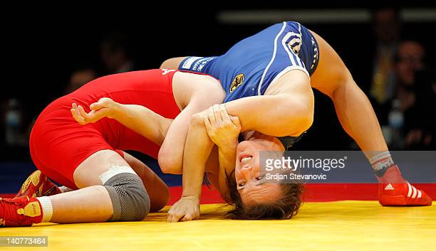 Lyudmyla Balushka of Ukraine fights against Jaqueline Saskia Schellin of Germany in the Woman's Freestyle 48kg during the European wrestling...