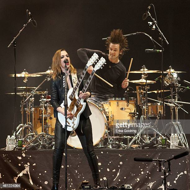 Lzzy Hale and Arejay Hale of Halestorm perform at Smoothie King Center on January 8 2015 in New Orleans Louisiana