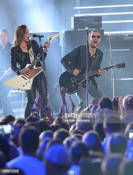 Lzzy Hale and Eric Church perform onstage at the 2014 CMT Music Awards at Bridgestone Arena on June 4 2014 in Nashville Tennessee