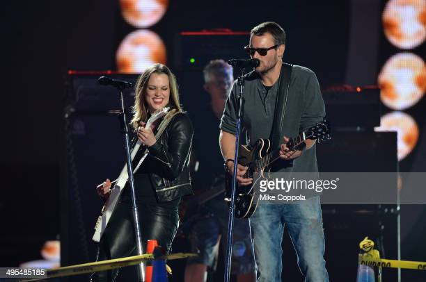 Lzzy Hale and Eric Church perform onstage at the 2014 CMT Music Awards Rehearsals Day 2 at Bridgestone Arena on June 3 2014 in Nashville Tennessee