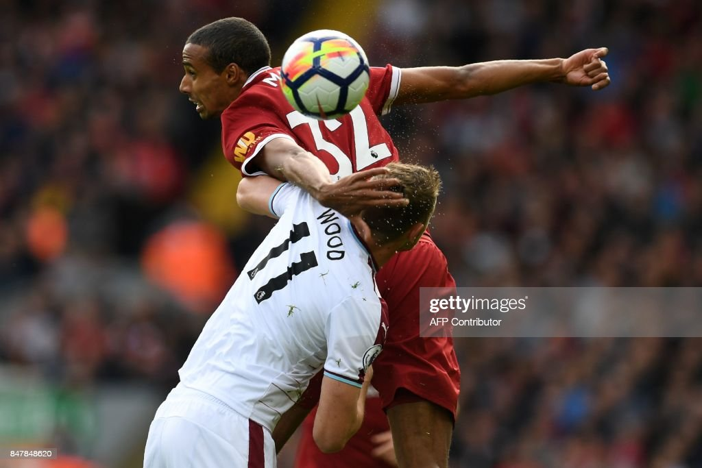 m Liverpool's German-born Cameroonian defender Joel Matip wins a header from Burnley's New Zealand striker Chris Wood during the English Premier League football match between Liverpool and Burnley at Anfield in Liverpool, north west England on September 16, 2017. / AFP PHOTO / Paul ELLIS / RESTRICTED TO EDITORIAL USE. No use with unauthorized audio, video, data, fixture lists, club/league logos or 'live' services. Online in-match use limited to 75 images, no video emulation. No use in betting, games or single club/league/player publications. /