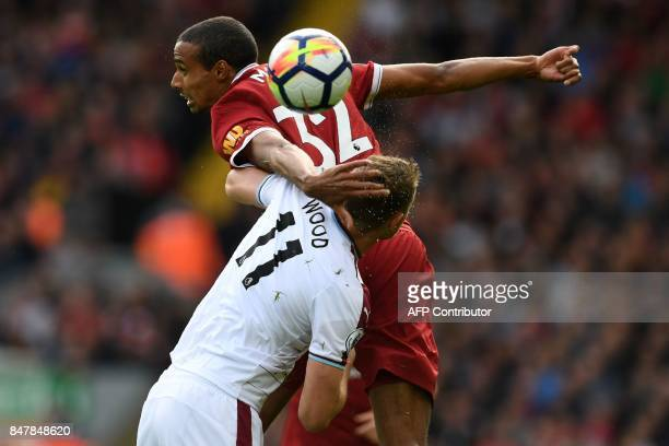 m Liverpool's Germanborn Cameroonian defender Joel Matip wins a header from Burnley's New Zealand striker Chris Wood during the English Premier...