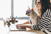 Young woman with dog in office