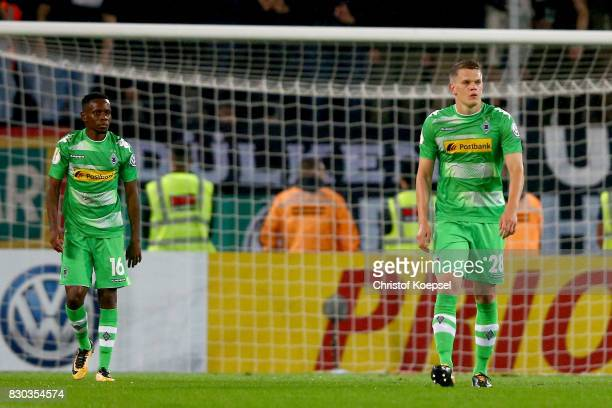 m18 and Matthias Ginter of Mnchengladbach look dejected after the first goal of Essen during the DFB Cup first round match between RotWeiss Essen and...