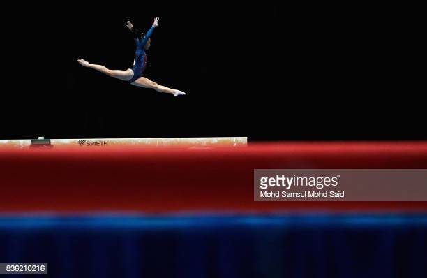 Ma Cristina Onofre of Philppines competes in the team artistic gymnastic balance beam qualifications team final event during the 29th Southeast Asian...
