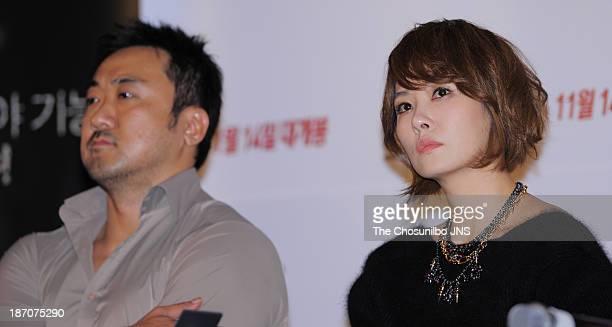 Ma DongSeok and Kim SunA attend the 'The Five' press conference at Wangsimni CGV on November 5 2013 in Seoul South Korea