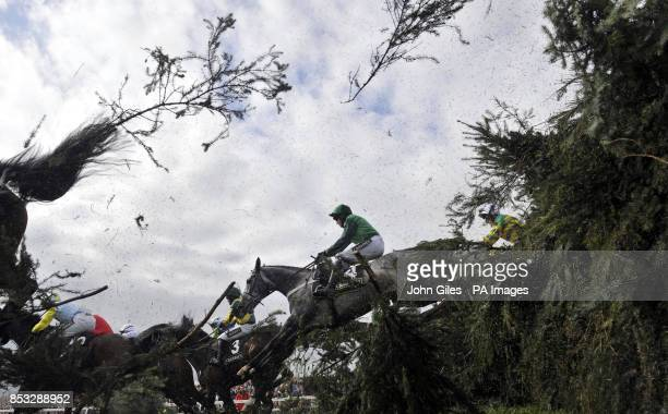 Ma Filleule ridden by Barry Geraghty jump the Chair fence on their way to victory in the Crabbies Supporting Everton in the Community Topham Chase...