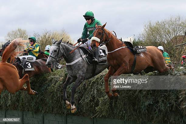 Ma Filleule ridden by Barry Geraghty jumps Becher's Brook on their way to victory in the Crabbie's Supporting Everton In The Community Topham Chase...