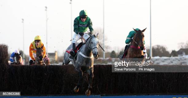 Ma Filleule ridden by Barry Geraghty wins the William Bet On The Move Handicap Steeple Chase during day two of the William Hill Winter Festival at...