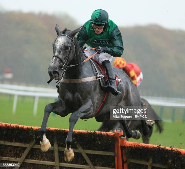 Ma Filleule ridden by David Bass jumps the last to win The bet365 Novices' Hurdle Race