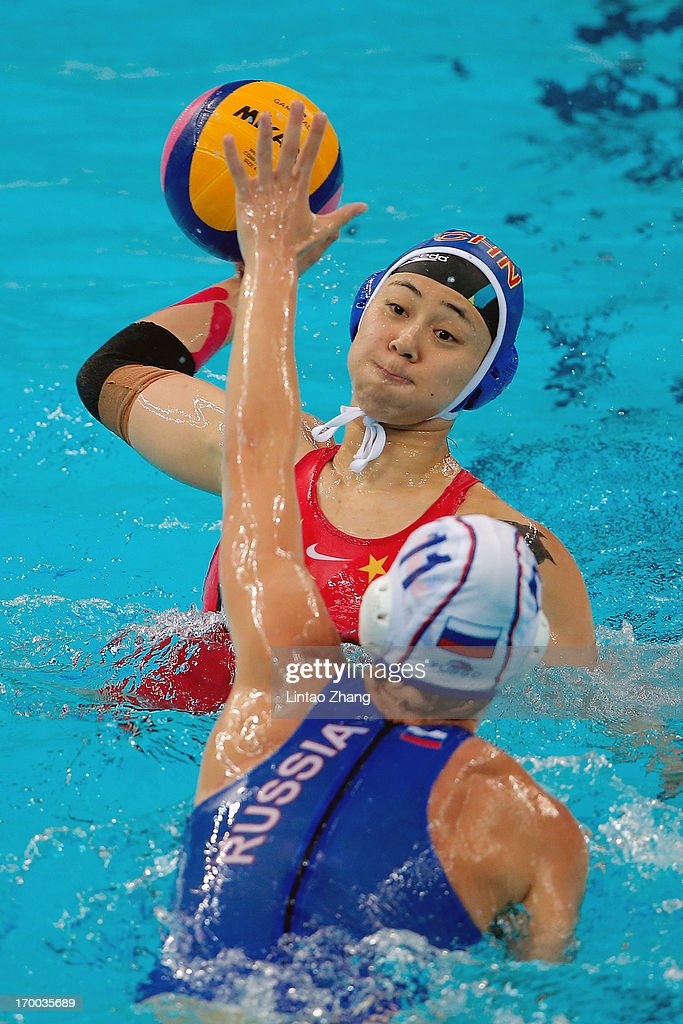 Ma Huahua of China challenges Ivanova Evgeniya of Russia during the Women's Water Polo Gold Medal match between the China and Russia on day six of...