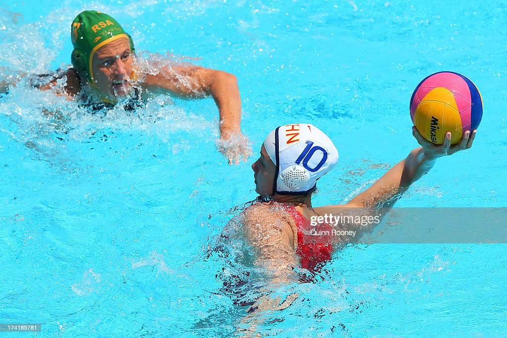 Ma Huanhuan of China passes the ball during the Women's Water Polo first preliminary round match between China and South Africa during Day Two of the 15th FINA World Championships at Piscines Bernat Picornell on July 21, 2013 in Barcelona, Spain.