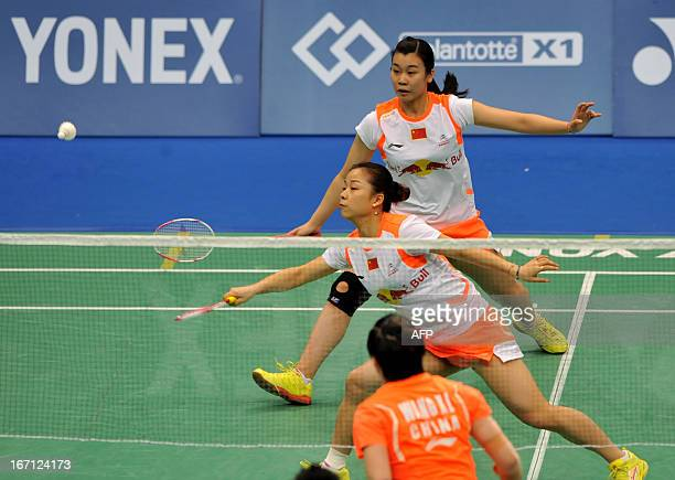 Ma Jin and Tang Jinhua of China hit a return against Wang Xiaoli and Yu Yang of China in their women's doubles final of the Badminton Asia...