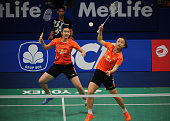 Ma Jin and Tang Yuanting of China return a shot against Tang Jinhua and Tian Qing of China during the 2015 BCA Indonesia Open Semifinals match at...