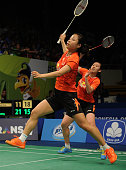 Ma Jin and Tang Yuanting of China returns a shot against Lee So Hee and Shin Seung Chan of Korea during the 2015 BCA Indonesia Open Quarterfinals...