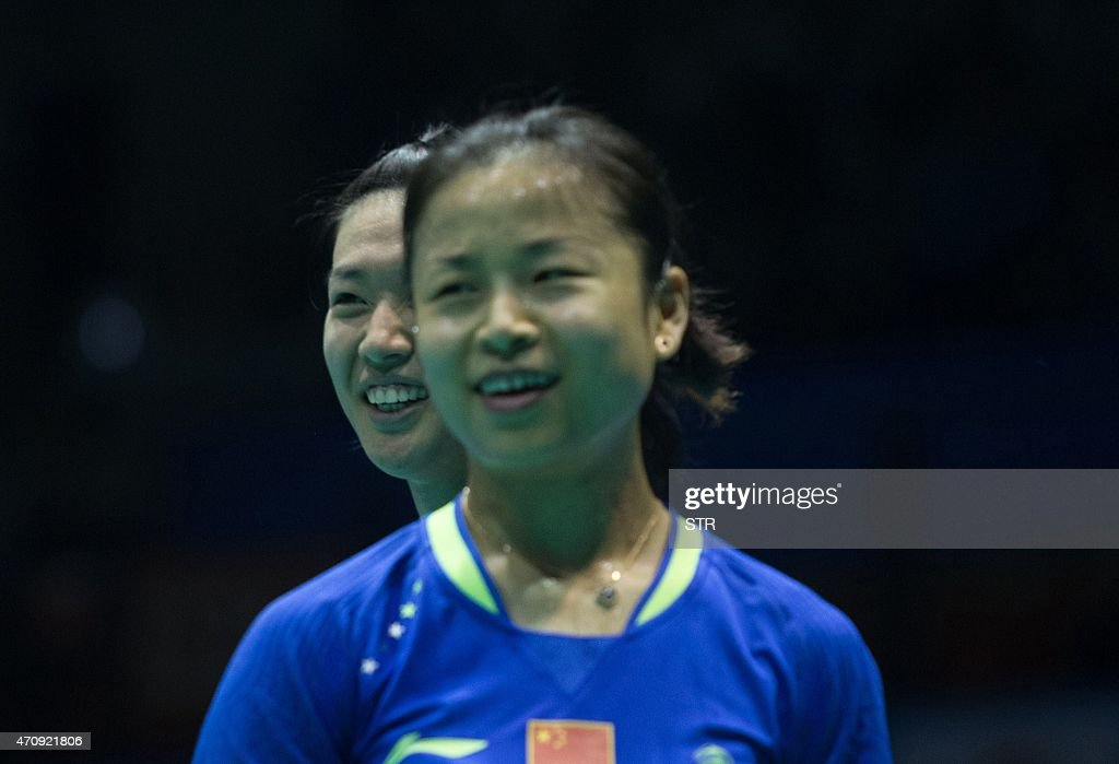 <a gi-track='captionPersonalityLinkClicked' href=/galleries/search?phrase=Ma+Jin&family=editorial&specificpeople=5747194 ng-click='$event.stopPropagation()'>Ma Jin</a> (R) and Tang Yuanting of China smile during their women's doubles quarter final match of the Badminton Asia Championships 2015 at the Wuhan Sports Center Gymnasium in Wuhan, central China's Hubei province on April 24, 2015. CHINA OUT AFP PHOTO