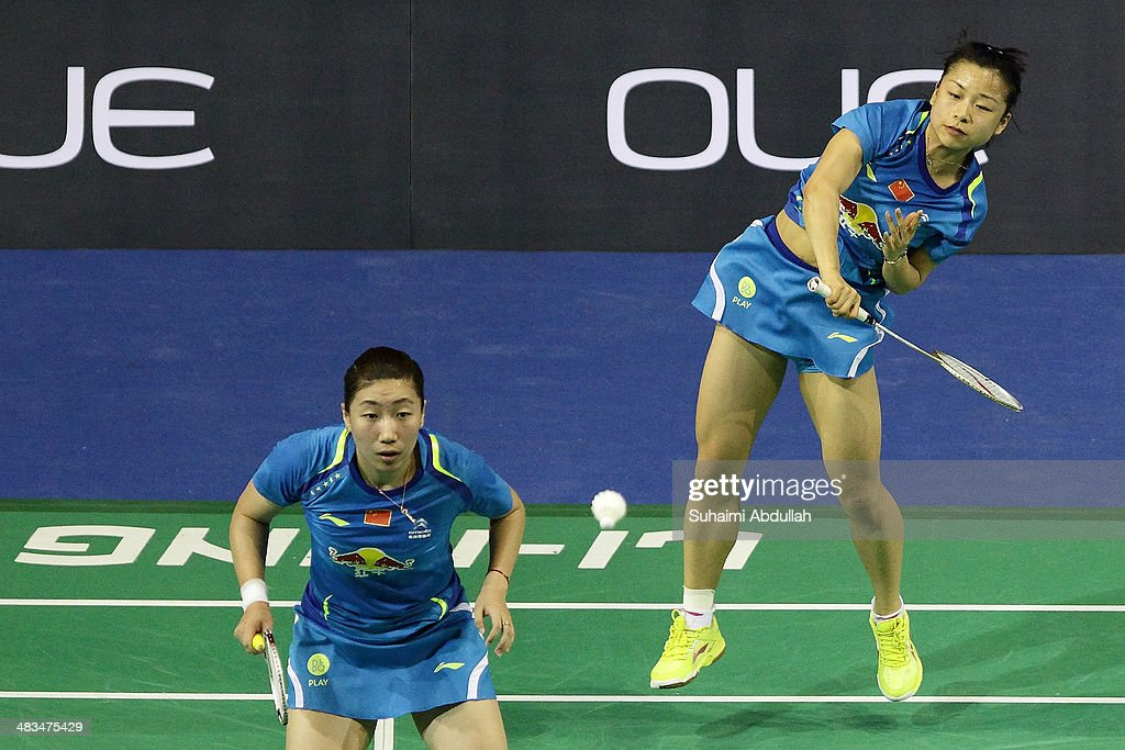 <a gi-track='captionPersonalityLinkClicked' href=/galleries/search?phrase=Ma+Jin&family=editorial&specificpeople=5747194 ng-click='$event.stopPropagation()'>Ma Jin</a> and Wang Xiaoli of China in action during the 2014 Singapore Open women's double round 1 match at Singapore Indoor Stadium on April 9, 2014 in Singapore.