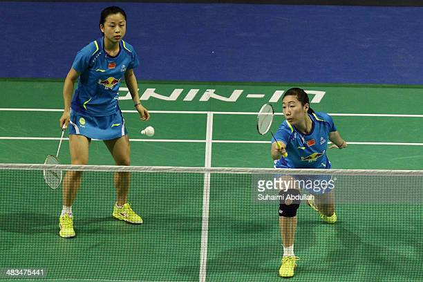 Ma Jin and Wang Xiaoli of China in action during the 2014 Singapore Open women's double round 1 match at Singapore Indoor Stadium on April 9 2014 in...