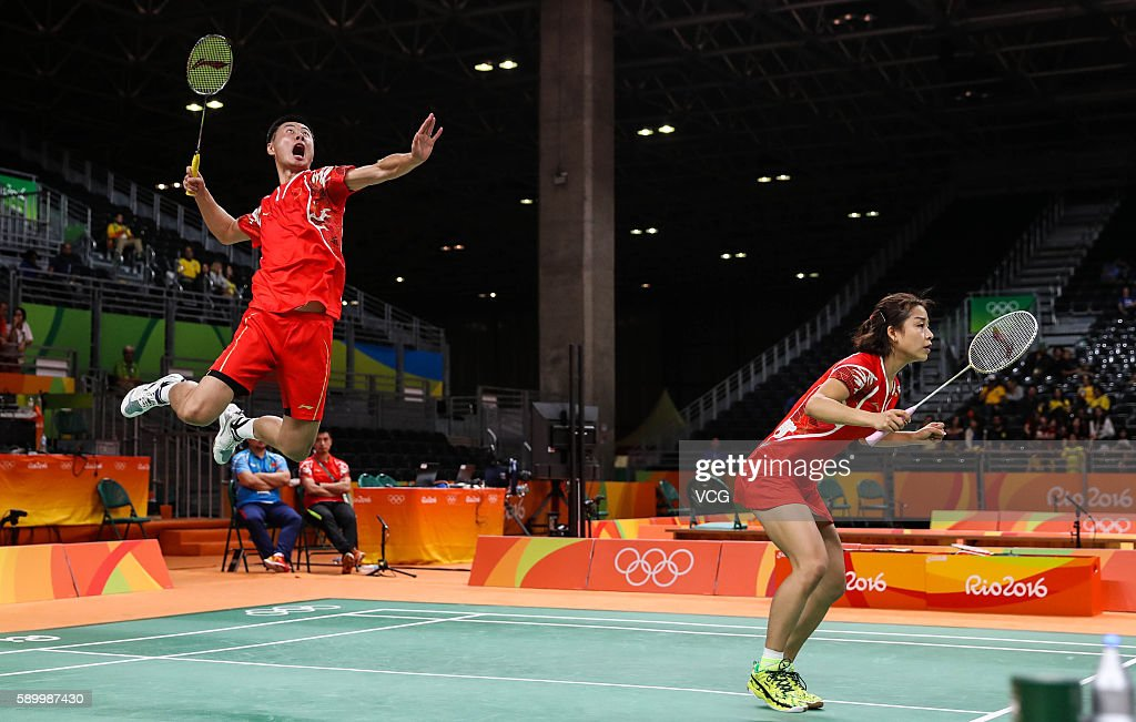 Ma Jin and Xu Chen of China compete during Badminton Mixed Doubles Quarter Final match against Ha Na Kim and Hyun Sung Ko of Korea on Day 9 of the...