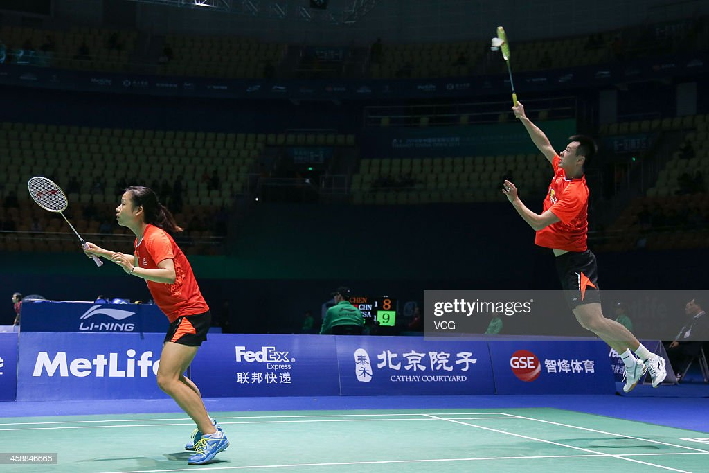 <a gi-track='captionPersonalityLinkClicked' href=/galleries/search?phrase=Ma+Jin&family=editorial&specificpeople=5747194 ng-click='$event.stopPropagation()'>Ma Jin</a> (L) and Xu Chen of China in action against Sam Magee and Chloe Magee of Ireland in the Mixed Doubles match on day two of the BWF 2014 Thaihot China Open at Haixia Olympic Sport Center on November 12, 2014 in Fuzhou, Fujian province of China.