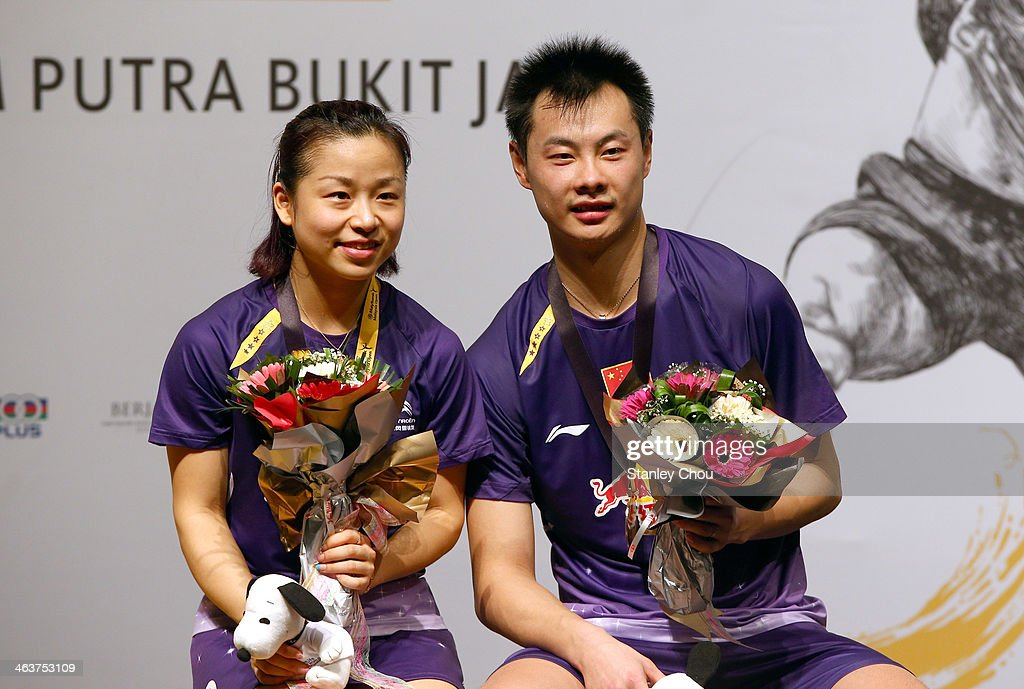<a gi-track='captionPersonalityLinkClicked' href=/galleries/search?phrase=Ma+Jin&family=editorial&specificpeople=5747194 ng-click='$event.stopPropagation()'>Ma Jin</a> and Xu Chen of China poses with their gold medals after they defeated Joachim Fisher Nielsen and Christian Pedersen of Denmark during the Final of the Mixed's Doubles of the Malaysia Badminton Open on January 19, 2014 in Kuala Lumpur, Malaysia.