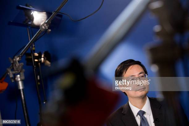 Ma Jun chief economist at the research bureau of the People's Bank of China sits ahead of a Bloomberg Television interview during Climate Finance Day...
