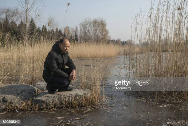 Ma Jun founder of the Institute of Public Environmental Affairs poses for a photograph in a park in Beijing China on Saturday Dec 2 2017 Ma's years...