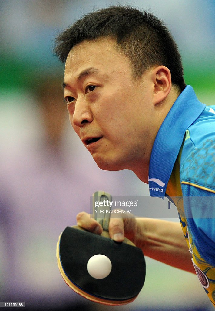 Ma Lin of China returns a service to Russian Alexander Shibayev during their men's teams group D match at the 2010 World Team Table Tennis Championships in Moscow on May 26, 2010.