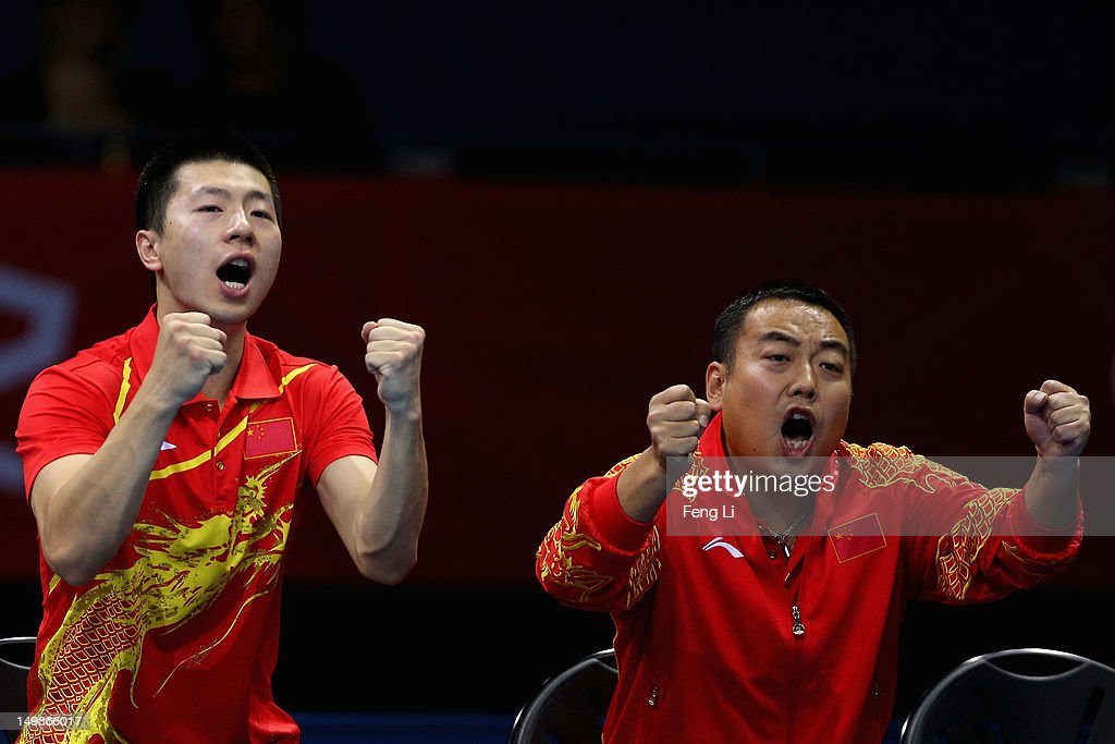 <a gi-track='captionPersonalityLinkClicked' href=/galleries/search?phrase=Ma+Long&family=editorial&specificpeople=2158981 ng-click='$event.stopPropagation()'>Ma Long</a> and coach <a gi-track='captionPersonalityLinkClicked' href=/galleries/search?phrase=Liu+Guoliang&family=editorial&specificpeople=655363 ng-click='$event.stopPropagation()'>Liu Guoliang</a> of China celebrates during Men's Team Table Tennis quarterfinal match against team of Singapore on Day 9 of the London 2012 Olympic Games at ExCeL on August 5, 2012 in London, England.